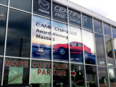 Large format car dealer showroom window graphics, perforated vinyl, Toronto Ontario