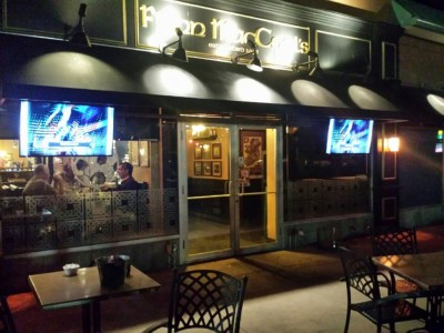Two outdoor TVs on a pubs patio