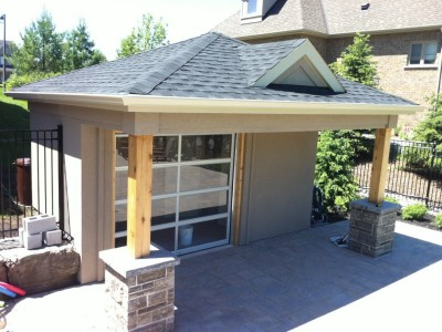 Stucco pavilion with glass panel over head door