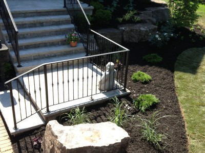 Custom wrought iron railing for this set of natural stone steps.