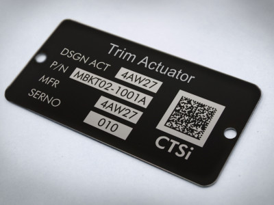 Durable black metal laser etched machine tags.
