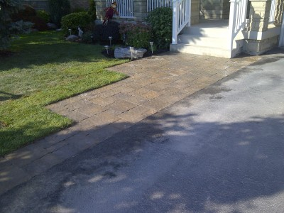 Creating a driveway band, which incorporates a front walkway can open up an entrance