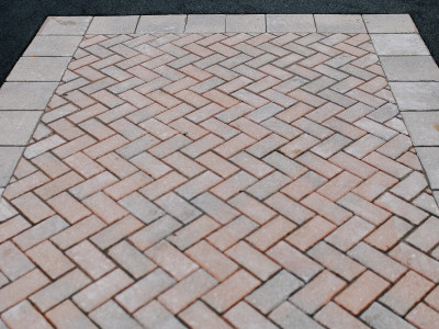 interlock detail in asphalt driveway
