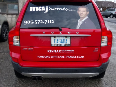 Vinyl lettering for real estate car.