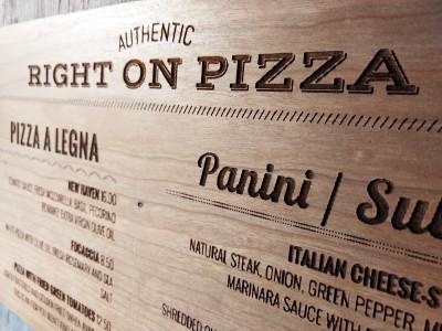 Laser engraved wooden pizza menu board.