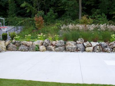 mossy boulders around sports pad