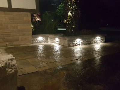 Hardscape lights in a wall, give off an amazing effect at night