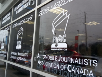 Car dealership vinyl windows graphic in Markham.