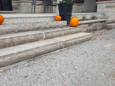 Large natural stone steps create an amazing front entrance