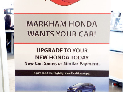 Retractable banner for dealership showroom.