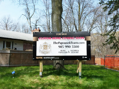 Large real estate sign for new build.