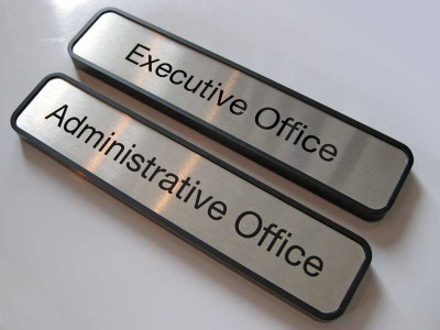 Engraved office identification signs.