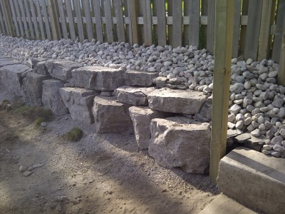 Create a interesting landscape feature with a armour rock wall