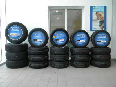 VW dealer tire marketing signs, Mississauga, Ontario.