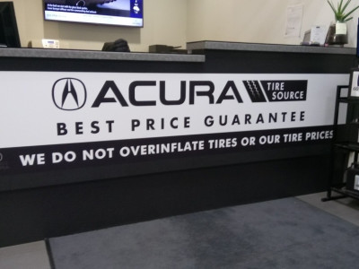Desk sign for car dealership.