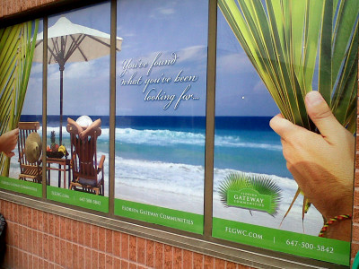 Travel agent perforated window graphics, Toronto, Ontario.