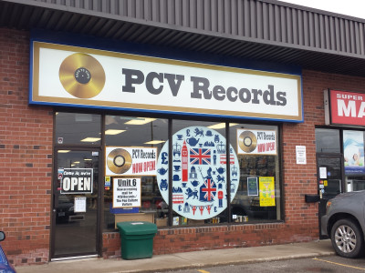 Storefront lightbox vinyl stripped and replaced, Oakville, Ontario.