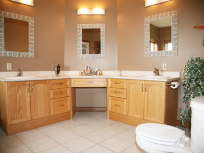 Master Ensuite BEFORE: The home owner asked us to work with the existing cabinetry, flooring and light fixtures.