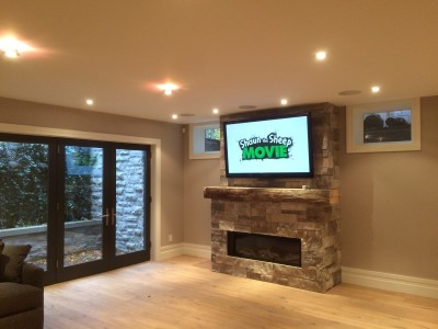 "58"" Panasonic Plasma Mounted above a Fireplace"