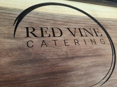 Logo engraved on cheese board.