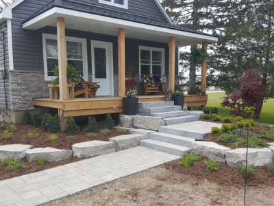 Country property landscape using armourstone and pavers