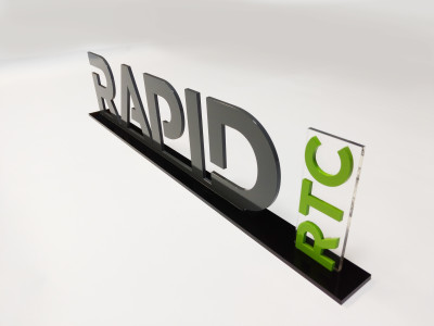Custom 3 dimensional acrylic logo on stand.
