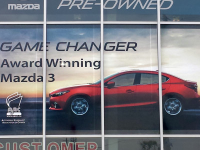 Perforated vinyl for dealership windows.