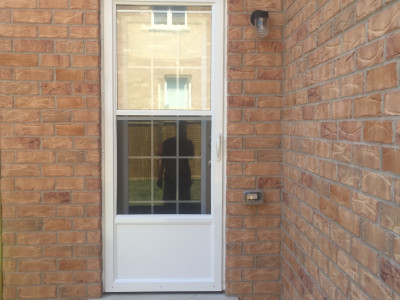 Photo 1 - home now with the new storm door installed