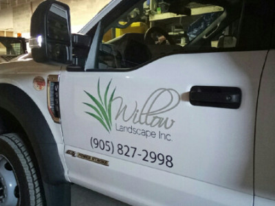 Vinyl cut logo on truck door.