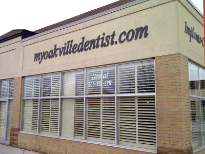"3 Dimensional 1/4"" laser cut acrylic logo pin mounted to stucco fascia, dentist sign, Oakville, Ontario."