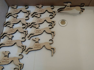 Laser cut and laser engraved plywood dog ornaments. 100 made for Appleby College, Oakville Ontario
