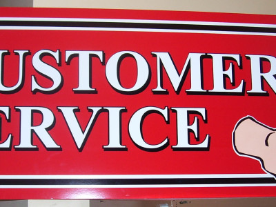 Contour cut PVC directional sign.