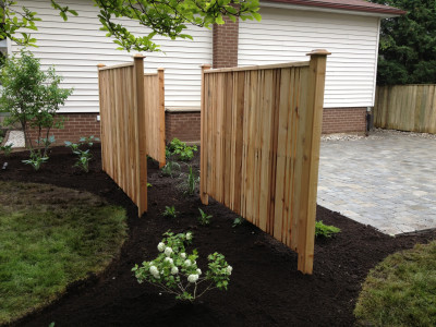 Privacy screens offer delineation of space without the uninteresting qualities of a fence.