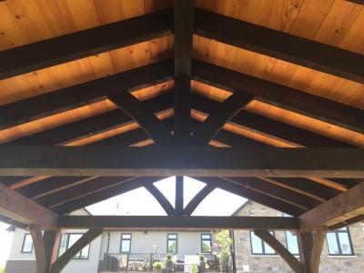 Rough sawn douglas fir roof cladding.