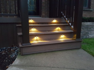 Hardscape lights help illuminate entrance steps