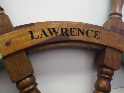 Engraved wooden boat wheel.
