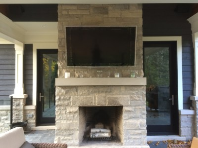 "50"" Sony TV Mounted above a Fireplace on an Outdoor Patio"
