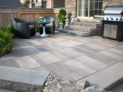 Large natural stone stairs define this patio