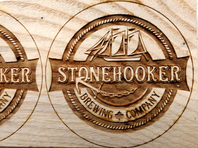 Engraved beer company logo in wood for beer pulls. Customer will be doing their own finishing.