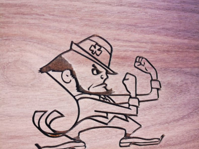 Laser engraved Notre Dame Leprechaun Fighting Irish mascot, walnut, Ontario Canada