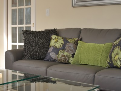 The large furniture pieces (sofa and accent chairs) and the wall colour had to be worked into a cohesive design scheme
