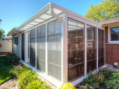 Natural Light Patio Cover's can be enclosed to create a three season sunroom.