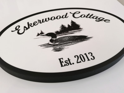 """1/2"""" wood plaque with laminated print."""
