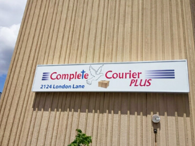 Vinyl cut logo on light box for a courier company, installed Oakville On.