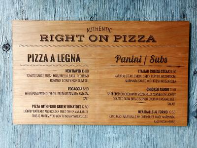 Engraved wooden menu board.