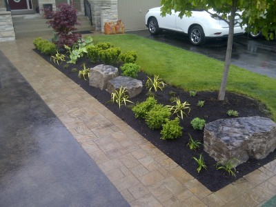 Driveway extension and a planting bed with armourstone