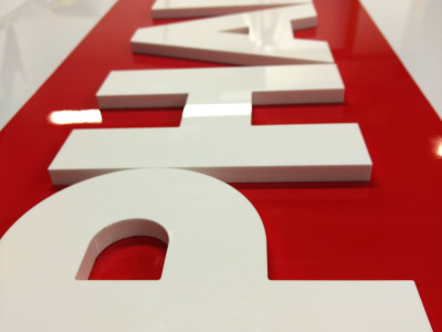 Aluminum box signs with 3 dimensional laser cut acrylic logos. Installed in Oakville, Ontario.