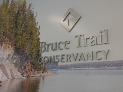 Bruce trail mural with 3D aluminum logo.