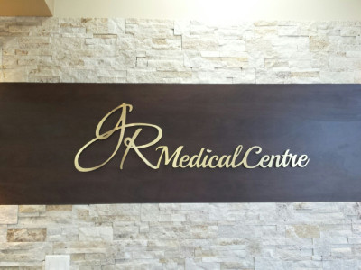Brushed gold aluminum laminate reception sign.