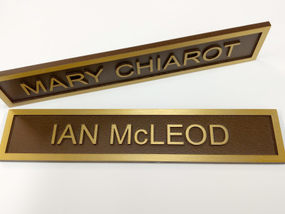 Brass name plaques.
